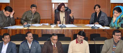 Deputy Commissioner Simrandeep Singh chairing a meeting at Jammu on Monday.