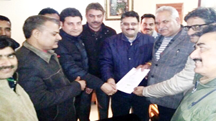 Diploma Engineers submitting memorandum to PHE Minister Sham Choudhary in Jammu on Wednesday.