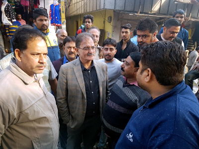 Speaker Kavinder Gupta interacting with people during his tour of Gandhi Nagar constituency on Friday.