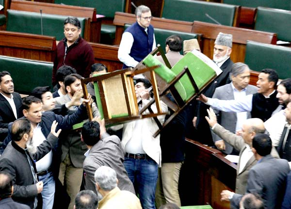 Amidst Opposition protests, NC MLA Altaf Ahmad Wani is seen throwing two chairs in the Assembly on Wednesday. Another pic on page 13. -Excelsior/Rakesh