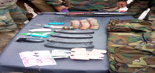 Arms and ammunition recovered from militants at Hajan, Bandipora on Tuesday.