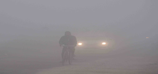 A cyclist braves dense fog in Jammu on Tuesday morning. -Excelsior/Rakesh