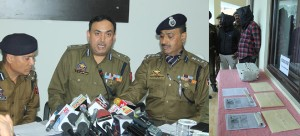 IGP Jammu SD Singh, flanked by DIG Ashkoor Wani and SSP PCR Ashok Sharma at a press conference in Jammu on Saturday (left) the fake currency and accused in police custody (rigt).  -Excelsior/Rakesh