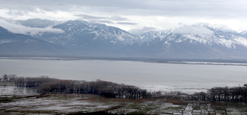 A view of snow covered mountains in Wular lake area of Bandipora in North Kashmir on Sunday.