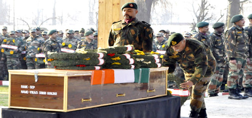 Army pays tributes to three soldiers, who were killed in a militant ambush at Shopian.      -Excelsior/ Rakesh