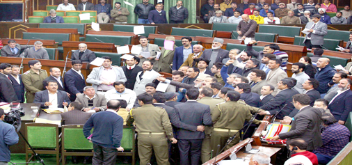 Opposition MLAs protest in the Assembly as papers flung in the air on Tuesday. -Excelsior/Rakesh