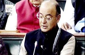 FM halves basic IT rate, says no cash dealings above Rs 3 lakh