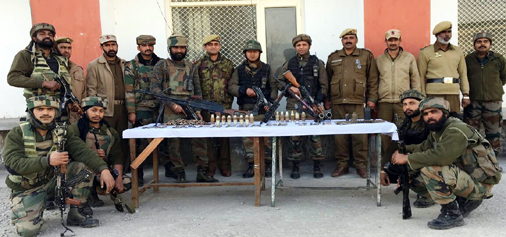 Security personnel pose with arms and ammunition recovered in Mendhar on Tuesday.