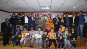 Meritorious sport climbers and mountaineers posing alongwith Chief Secretary BR Sharma and other dignitaries during prize distribution function.