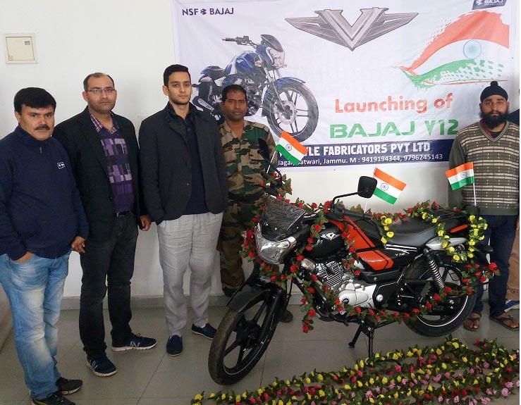 Officials of Bajaj Auto Ltd. and New Style Fabricators (P) Ltd., Satwari during the launch of 'Bajaj V12' motorcycle.