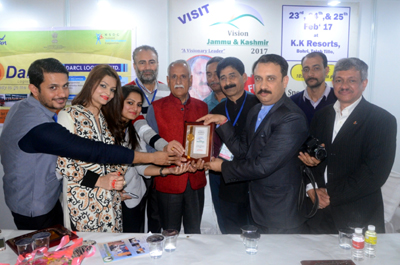 PowerGrid officials receiving best stall trophy from MP Shamsher Singh Manhas on Saturday.