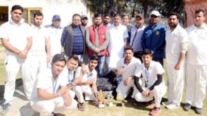 Winners posing for a group photograph after registering victory in Friendship Cup T20 match in Jammu.