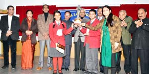 Winners of Debate Competition being felicitated by the dignitaries at Dogra Law College on Saturday.