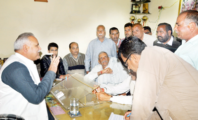 Minister for PHE Sham Lal Choudhary speaking during public grievances redressal meet on Saturday.