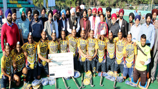 Winners of 4th Sant Gurbaksh Singh Danna Memorial Hockey Tournament posing alongwith Simrandeep Singh, Deputy Commissioner Jammu on Sunday.