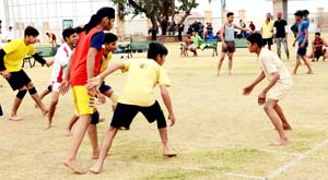 Players sweating it out during a match of International Kabaddi Tournament at Katra.