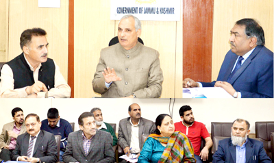 Minister for Revenue A R Veeri chairing a meeting at Jammu on Thursday.