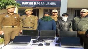 Burglars in the custody of police.
