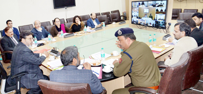 Minister for Education Syed Mohammad Altaf Bukhari chairing a meeting at Jammu on Thursday.