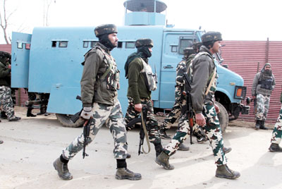 Troops in action during encounter at Hajan, Bandipora on Tuesday.