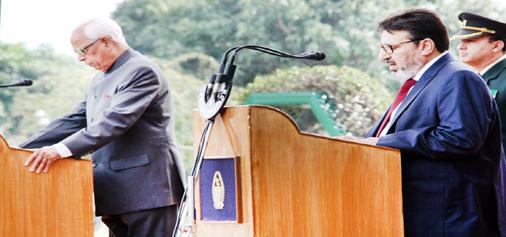 Governor N N Vohra administering of office and secrecy to PDP leader Syed Altaf Bukhari at Raj Bhavan, Jammu on Friday.-Excelsior/ Rakesh