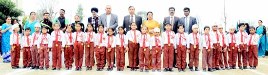 Children of Stephen International Public School posing for a photograph alongwith dignitaries during Sports Day on Saturday.