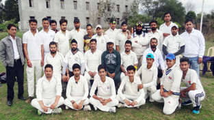 Teams posing for a group photograph alongwith Director Country Cricket Academy during a match of Chief Minister's Cricket Cup at Gharota in Jammu.