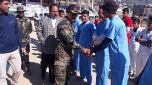 Army officer interacting with players during inaugural ceremony of T-10 Cricket Tournament.