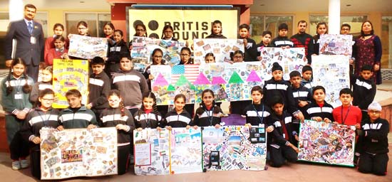 Participants of Collage Making Competition posing for a group photograph at GD Goenka Public School in Jammu.