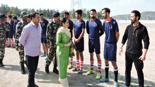 Dignitaries interacting with footballers in the inaugural match of ssb Football Tournament in Jammu.