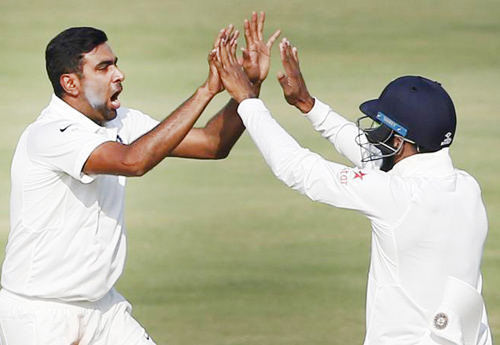 R Ashwin celebrating dismissal of Tamim Iqbal along with team mate at Hyderabad on Sunday.