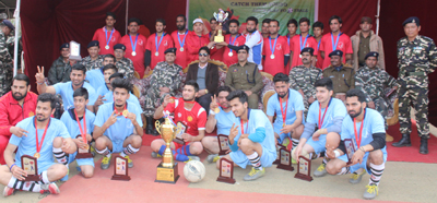 Winner of Football Tournament posing for a group photograph alongwith prizes during concluding ceremony of Football Tournament in Ramban.