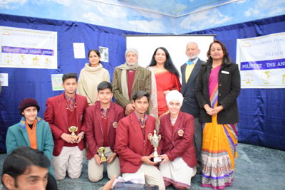 Winners of Polifest posing for a group photograph alongwith dignitaries at Jodhamal School in Jammu.