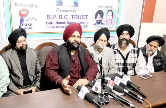 Organisers of Hockey Tourney addressing media persons in Jammu on Saturday. -Excelsior/Rakesh