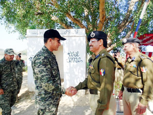 BSF officials and Rangers during flag meeting at Octroi, R S Pura on Wednesday.