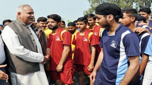Minister for PHE, Irrigation & Flood Control, Sham Lal Choudhary interacting with vollyeball players at Suchetgarh in Jammu on Monday.