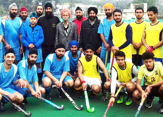 Teams posing for a group photograph during Senior Hockey Tournament at KK Hakhu Stadium in Jammu.