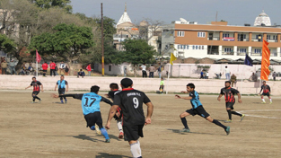 Footballers in action during a match of SSB Footbal Tournament in Jammu.