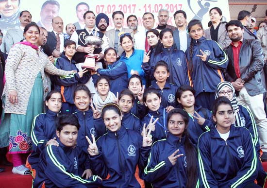 Jubilant J&K Girls Tennis Cricket team holding trophy while posing for a group photograph alongwith Minister of State for Sports and other dignitaries in Jammu. -Excelsior/Rakesh