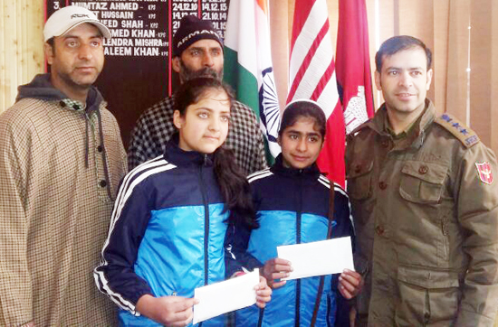 Young Sqay players who will represent the Country posing for a photograph with SSP Shopian, Tahir Saleem.