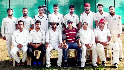 Players of triumphant Zabarwan CC Nishat posing for a group photograph after beating Azhar XI at Gharota in Jammu.