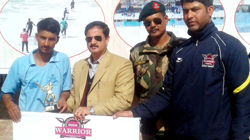 Kasif of Doda Riders being presented man of the match award by the dignitaries at Sports Stadium in Doda.