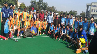 Winners posing alongwith dignitaries and officials at KK Hakhu Astroturf Stadium in Jammu on Wednesday.