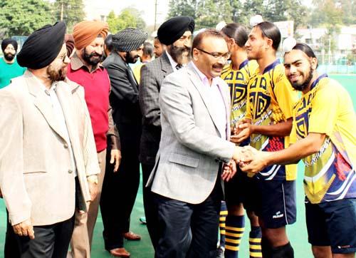 ADGP Security, Dilbag Singh interacting with hockey players at KK Hakhu Astroturf Stadium in Jammu on Saturday.