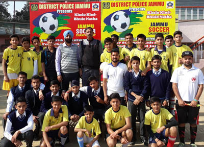Winners BSF School Paloura posing for a group photograph alongwith Rajesh Gill, Chief Prosecuting Officer and Coordinator of the event.