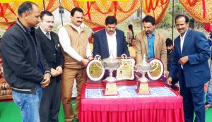 Divisional Sports Officer (J) State Sports Council, Ravi Singh and ace former cricketer Ashwani Gupta alongwith other dignitaries unveiling trophies while inaugurating Chief Minister's Cup at Gharota in Jammu.