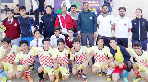 KC Public School team posing for a group photograph along with officials and organisers during a Soccer Championship at Parade ground in Jammu.