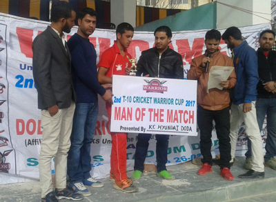 Man of the match award being presented to winner by the chief guest at Sports Stadium in Doda.