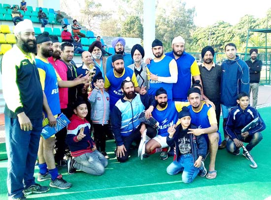 Winners of Hockey Tournament posing for a group photograph alongwith chief guest at K K Hakkhu Stadium on Saturday.