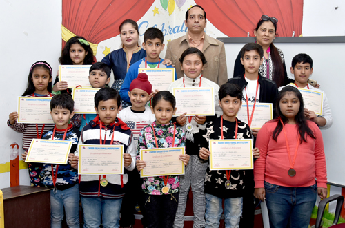 Children posing for a group photograph during award ceremony organised by Career Abacus in Jammu.